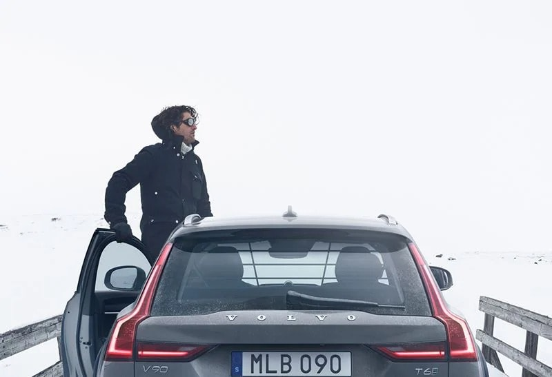 A man standing out of a Volvo